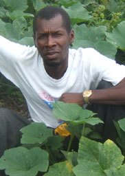 Abner Sauveur with pumpkins in Haiti